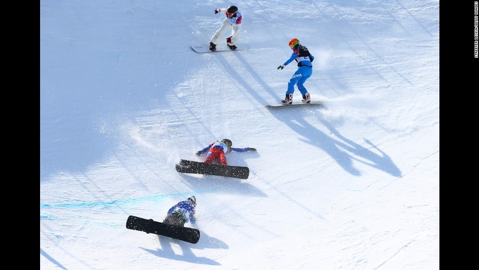 Snowboarders fall during the quarterfinals of women's snowboard cross on Sunday, February 16.