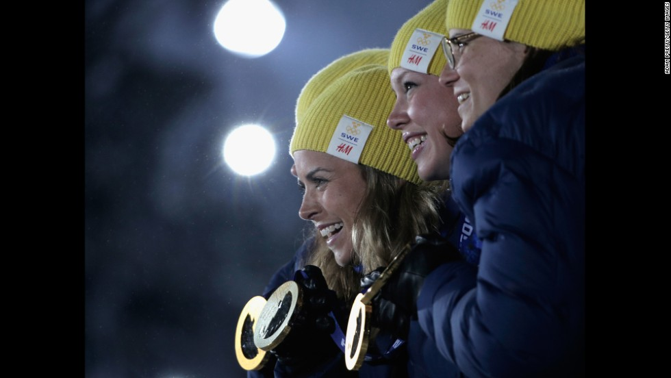 The Swedish team celebrates taking the gold in the women's cross-country relay on February 16.