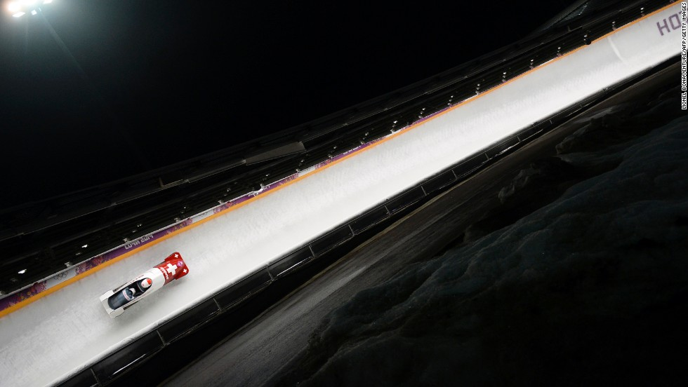 Switzerland's Rico Peter and Juerg Egger race in the bobsled event February 16.