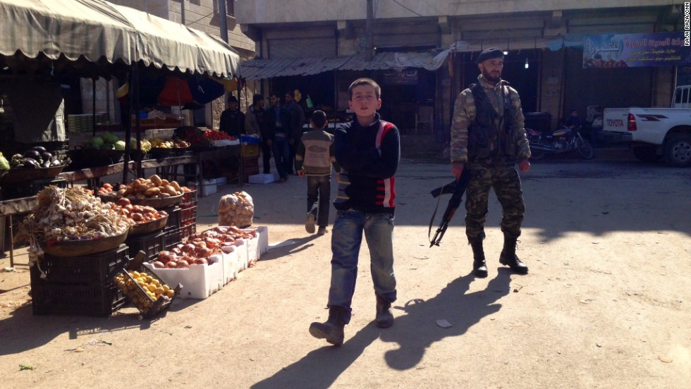 People shop and sell goods in the town center midday in Addana.  Under ISIS rule, shops were forced to close for the noon prayers, and activities such as smoking were banned. Those who violated the rules were executed or just disappeared.