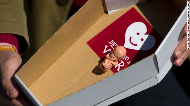 "A member of anti-abortion organization ""Derecho a vivir""  (The right to live) holds a mock coffin during a protest in Madrid."