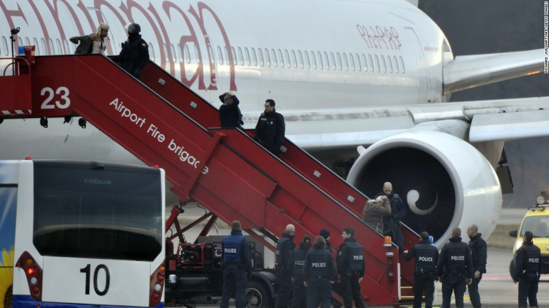 Police evacuate passengers on February 17, 2014 from the Ethiopian Airlines flight en route to Rome, which was hijacked and forced to land in Geneva, where the hijacker was arrested, police said.