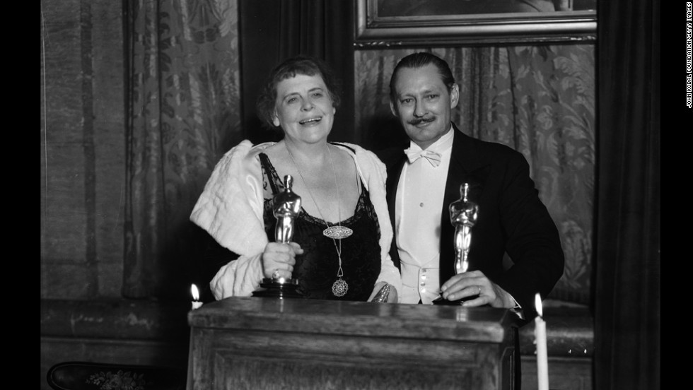"Marie Dressler and Lionel Barrymore collect their best actress and best actor Oscars in 1931. Dressler won for ""Min and Bill"" and Barrymore won for ""A Free Soul."""