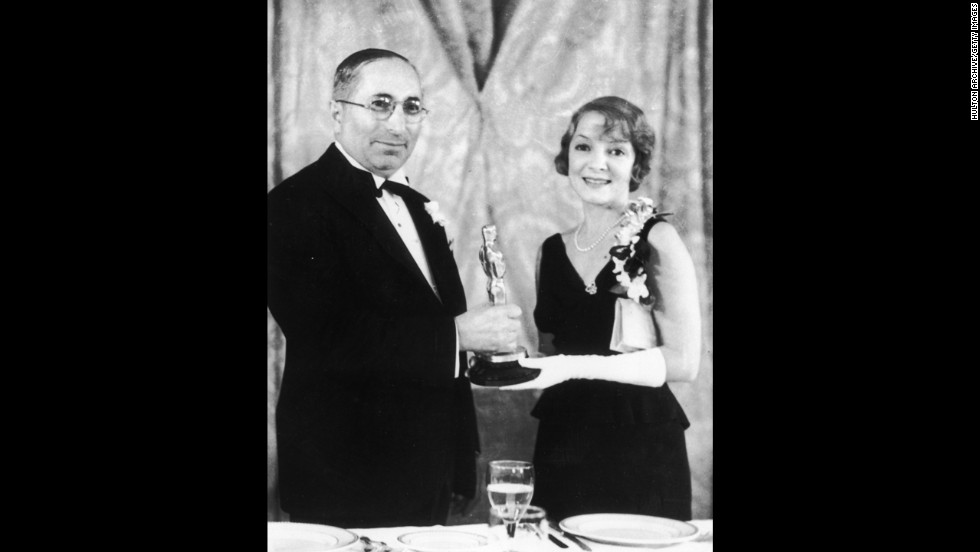 "Film producer Louis B. Mayer presents the best actress Oscar to Helen Hayes for her role in ""The Sin of Madelon Claudet."""