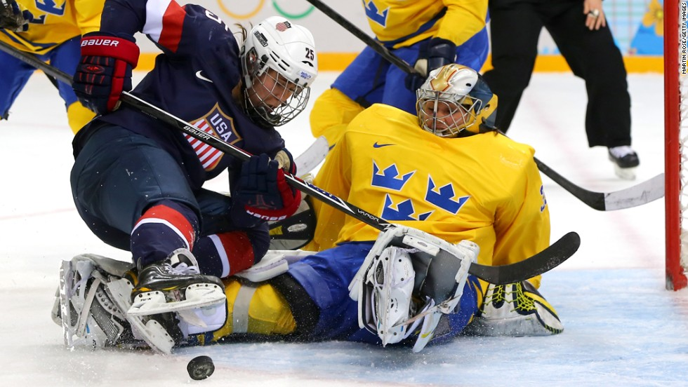 Women's hockey player Alex Carpenter of the United States tries to shoot against Valentina Lizana Wallner of Sweden during their semifinal game February 17.