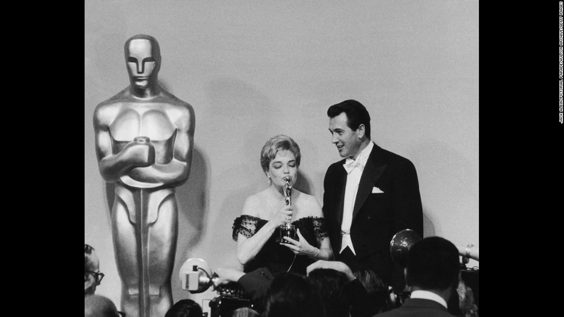 "Actress Simone Signoret, seen here next to actor Rock Hudson at the Academy Awards ceremony in 1960, won the best actress Oscar for her role in ""Room at the Top."""