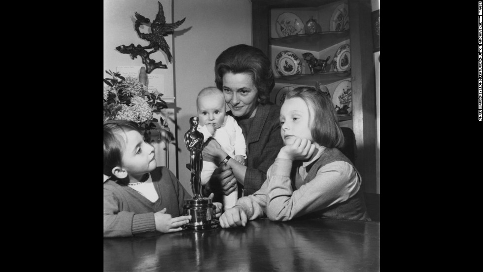 "Patricia Neal and her three children look at her Oscar statuette, which she won in 1964 for her role in ""Hud."""