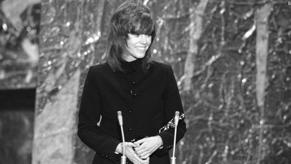 "Jane Fonda cradles the best actress Oscar she received for ""Klute."""