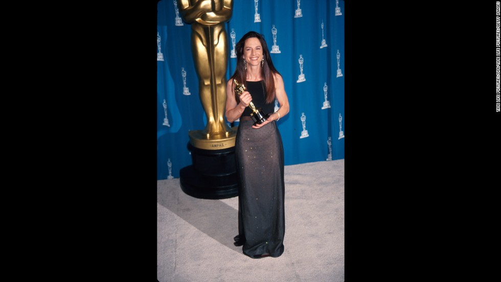 "Holly Hunter poses in the press room after being awarded the best actress Oscar for her performance in ""The Piano."""