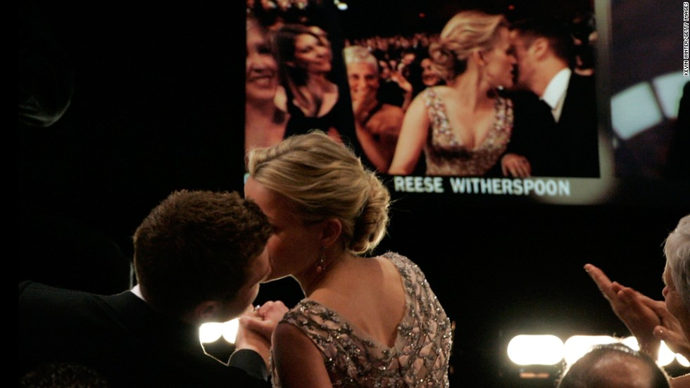 "Reese Witherspoon kisses then-husband Ryan Phillippe before going on stage to accept the best actress award for ""Walk the Line."""