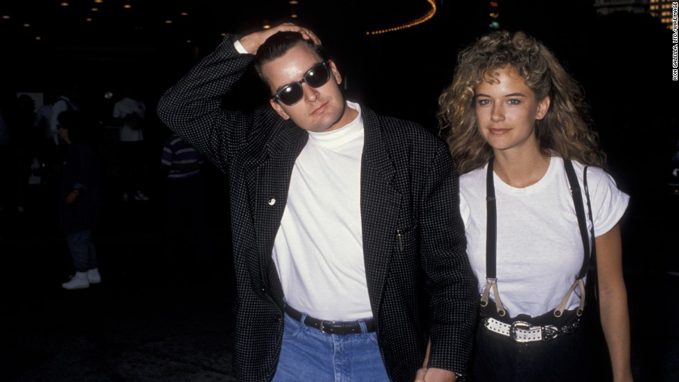 "Before she married John Travolta, actress Kelly Preston was the main squeeze of Charlie Sheen. In 1990 Preston was injured when a gun discharged in the couple's home and the pair soon ended their engagement.<a href=""http://www.eonline.com/news/239915/did-charlie-sheen-really-shoot-kelly-preston-21-years-later-we-get-the-answer"" target=""_blank""> In 2011, Sheen went on record</a> to say he didn't shoot Preston, but that his revolver accidentally went off after it fell out of a pair of his pants she picked up in the bathroom."