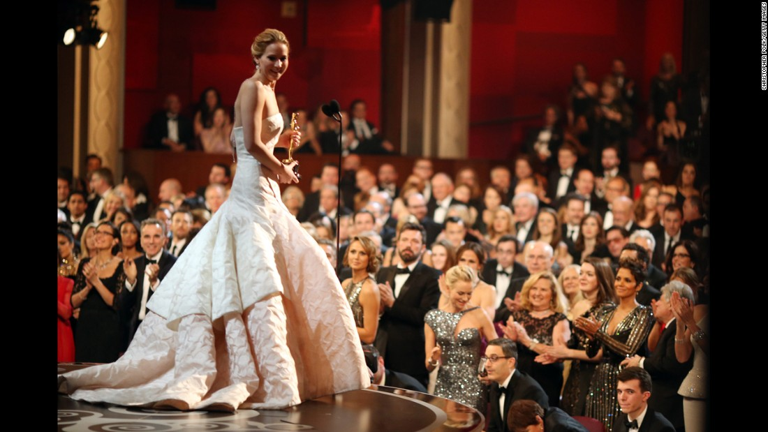 "Jennifer Lawrence charms the audience in 2013 as she accepts the best actress Oscar for her performance in ""Silver Linings Playbook."""