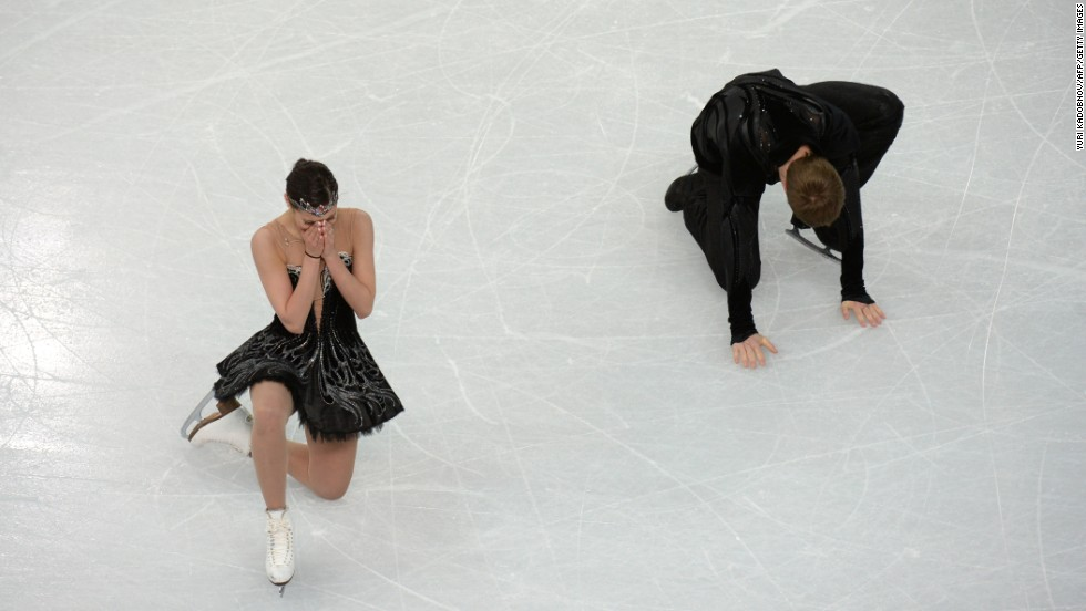 Russia's Nikita Katsalapov and Elena Ilinykh react after their ice dancing performing on February 17.