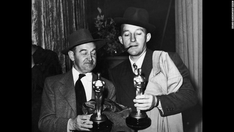 "Bing Crosby, right, and co-star Barry Fitzgerald find a reason to celebrate after the 1945 awards ceremony. They won the best actor and best supporting actor awards, respectively, for ""Going My Way."""