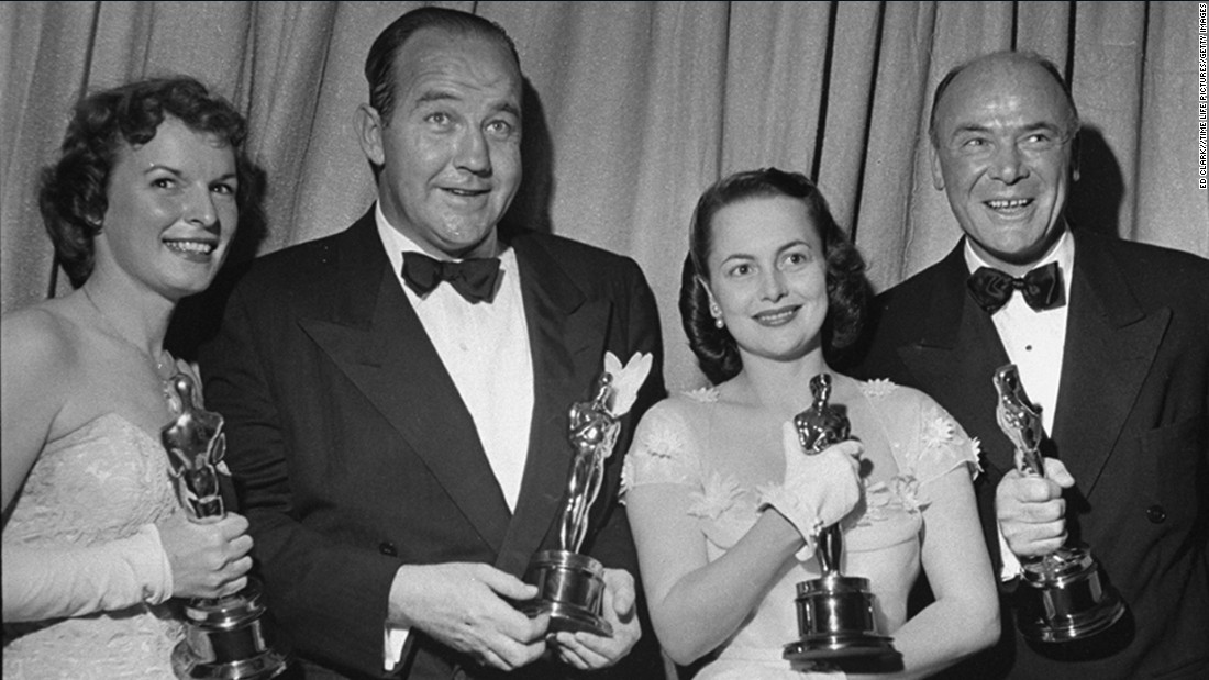 "Broderick Crawford, second from left, pushed past Kirk Douglas, Gregory Peck, Richard Todd and John Wayne to win the best actor Oscar with ""All the King's Men."" Crawford appears with best supporting actress winner Mercedes McCambridge, far left, best actress winner Olivia de Havilland and best supporting actor winner Dean Jagger at the 1950 ceremony."
