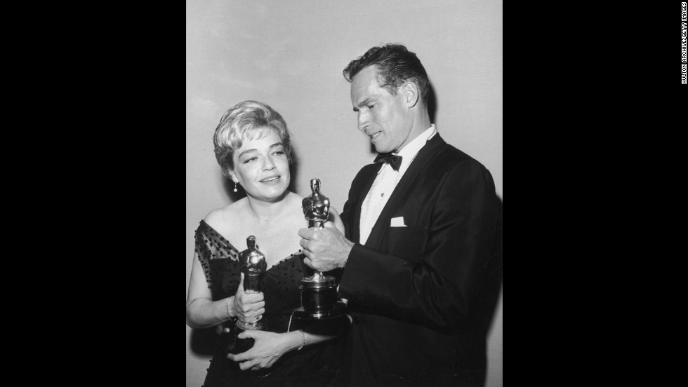 "Charlton Heston helped ""Ben-Hur"" to win a record 11 Academy Awards, shutting out Jack Lemmon, James Stewart, Paul Muni and Laurence Harvey as best actor. Heston appears with French actress Simone Signoret (best actress for ""Room at the Top"") at the 1960 ceremony."