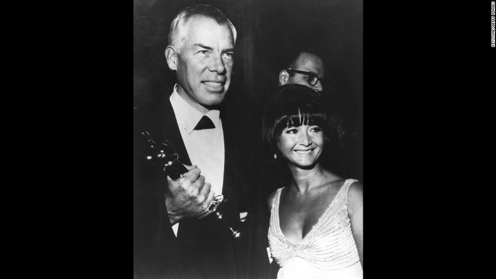 "Lee Marvin won the Oscar for his comic role in ""Cat Ballou"" over dramatic heavyweights such as Laurence Olivier in ""Othello,"" Richard Burton in ""The Spy Who Came in From the Cold,"" Rod Steiger in ""The Pawnbroker"" and Oskar Werner in ""Ship of Fools."" Here, Marvin appears with then-girlfriend Michelle Triola in 1966."
