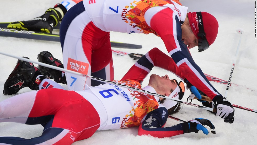 Norway's Joergen Graabak, bottom, celebrates with Norway's Magnus Hovdal Moan after the large hill Nordic combined event on February 18. Graabak won gold and Moan won silver.