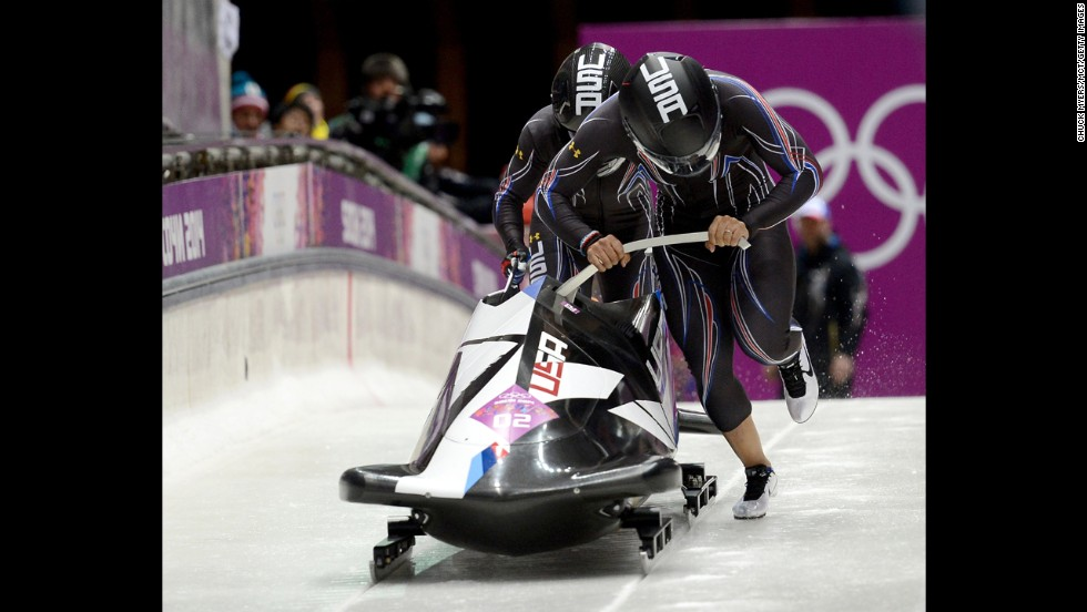 Americans Elana Meyers and Lauryn Williams start their first run in the women's bobsled on February 18.
