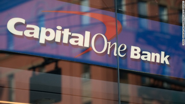 A Capitol One branch reflects a New York building. The bank said it does not send debt collectors to homes or offices.