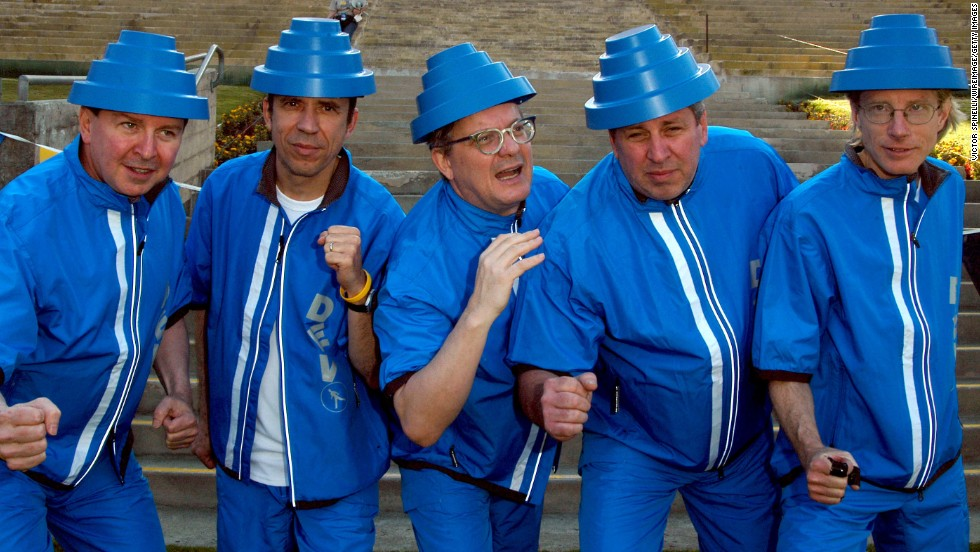 From left, band members Gerald Casale, Bob Mothersbaugh, Mark Mothersbaugh, Bob Casale and David Kendrick appear together at a concert in April 2004. The band actively toured in recent years, including a televised performance playing at the 2010 Winter Olympics.