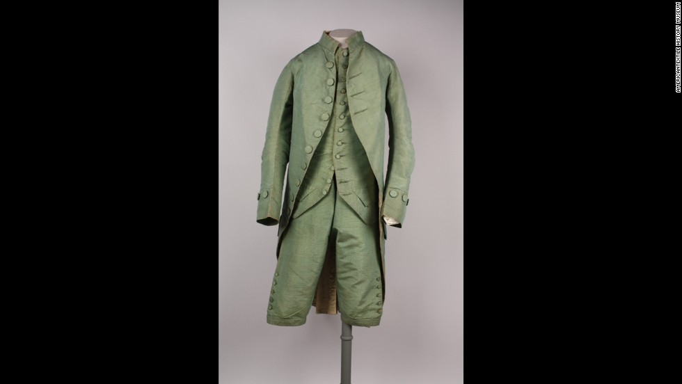 For nearly two centuries, a man in America would not leave his house without wearing a complete suit. Drinking coffee -- or more likely tea or drinking chocolate -- in an 18th century cafe would have compelled a man to display an outfit of finery. This three-piece suit would have been worn by someone in the upper class.