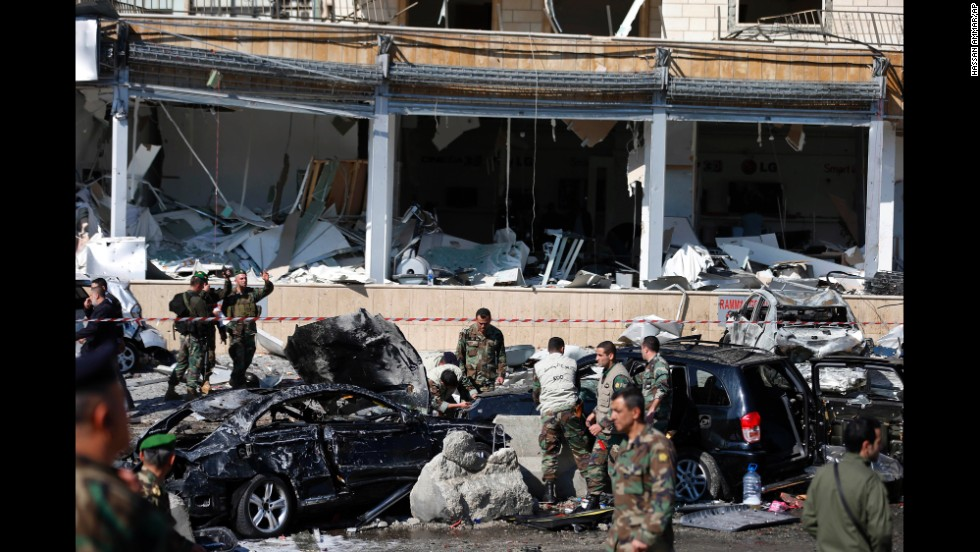 Lebanese army investigators inspect damaged vehicles near Iran's cultural center in Beirut on February 19.