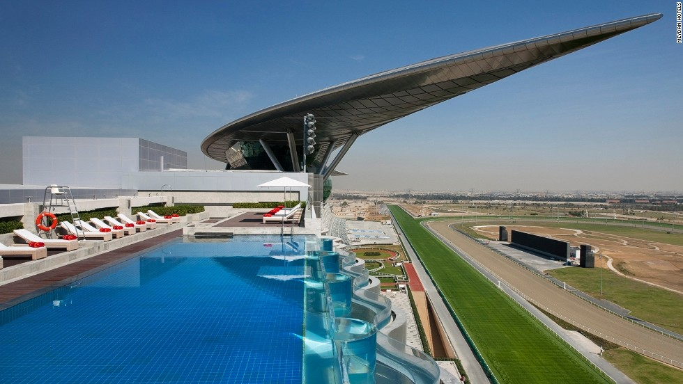 The infinity pool at the top of the Meydan has stunning views of both the racecourse and its signature crescent roof.