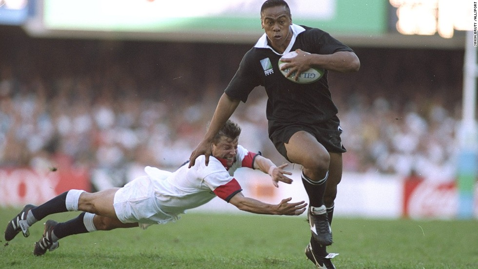Lomu burst onto the scene at the 1995 World Cup, scoring four tries against England in the semifinals. Here, a desperate Rob Andrew fails in a last-ditch attempt to tackle the big man.