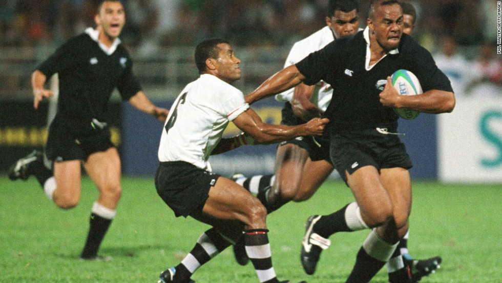 "Lomu in action during the 1998 Commonwealth Games against Fiji, where not even the great Waisale Serevi (left) can stop him. New Zealand would go on to take the gold medal. Lomu was a passionate advocate of sevens: ""The greatest thing I love about it is the camaraderie that the players have among all the nations ... that come together to make this beautiful game."""