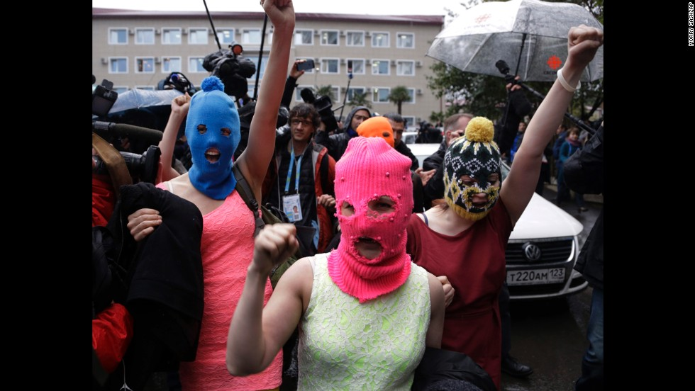 Pussy Riot members make their way through a crowd after they were released on February 18.