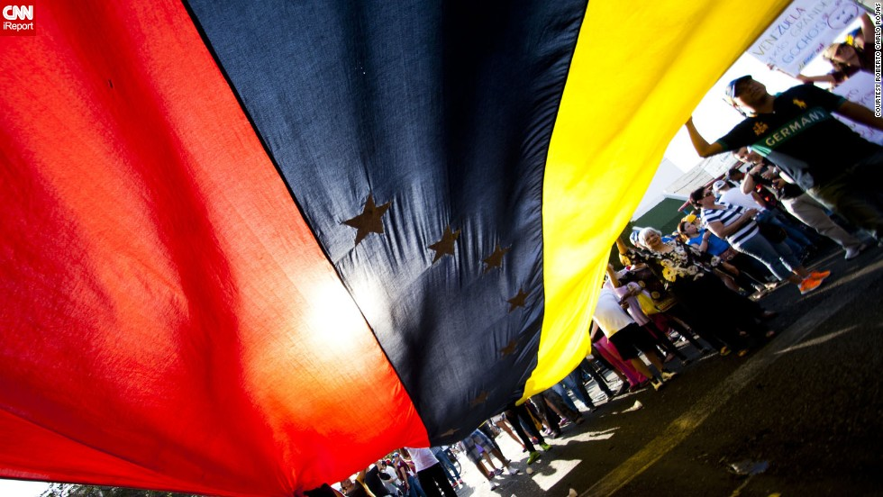 "Protesters often rally with the Venezuelan flag, says <a href=""http://ireport.cnn.com/docs/DOC-1086169"">Roberto Carlo Rojas</a>, a professional photographer who supports the protesters. ""Nothing that the government says (about the protests) is real,"" he said. He captured this photo on February 16 in Maracaibo."