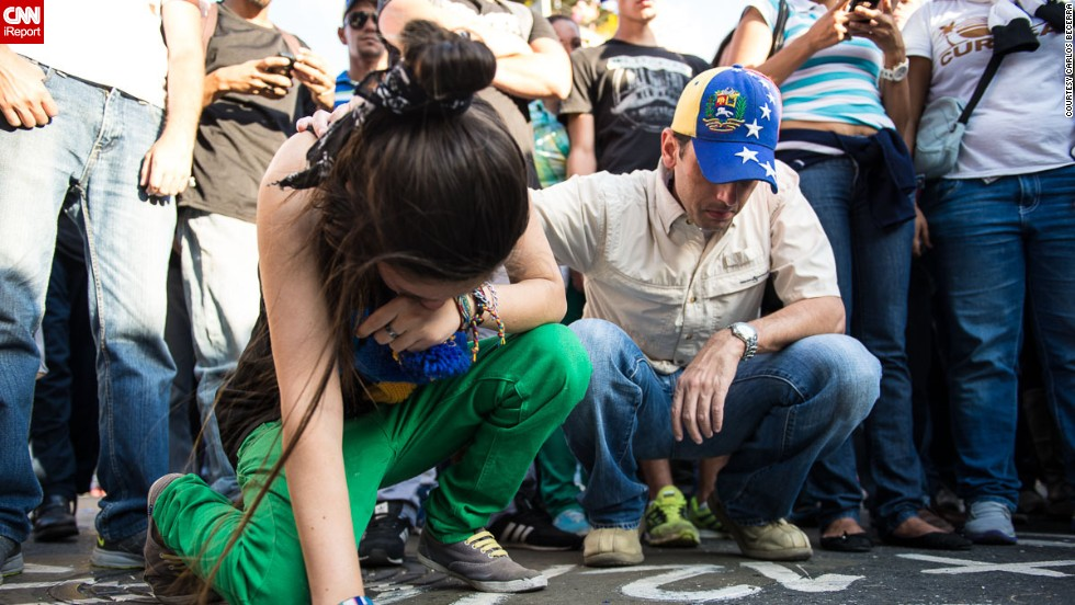 "A young <a href=""http://ireport.cnn.com/docs/DOC-1084811"">woman cries</a> on February 13 at the place where one of the opposition members was killed a day before in Caracas. <br />"