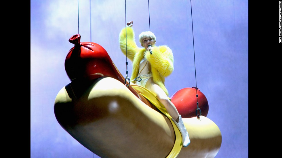Cyrus rides an oversized hotdog during the Bangerz Tour opening concert in Vancouver, Canada.