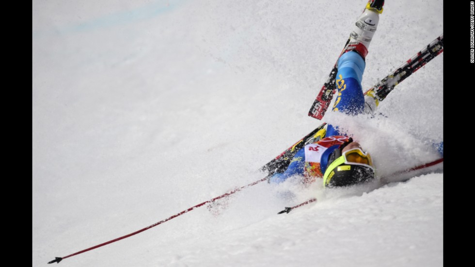 Dow Travers of the Cayman Islands crashes during the men's giant slalom on February 19.