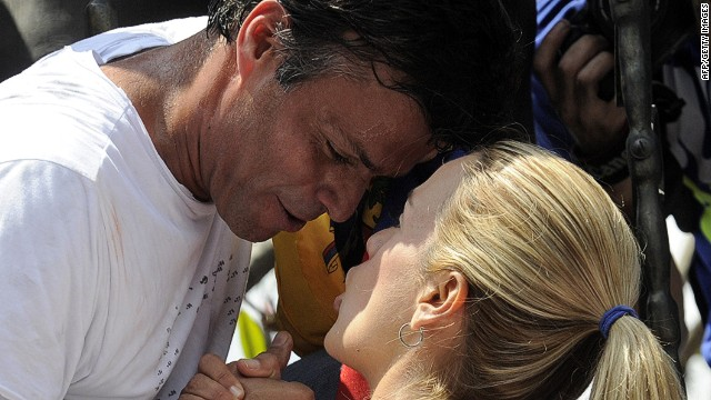 Leopoldo Lopez, an ardent opponent of Venezuela's socialist government facing an arrest warrant after President Nicolas Maduro ordered his arrest on charges of homicide and inciting violence, kisses his wife Lilian Tintori, during a demonstration before turning himself in to authorities, in Caracas on February 18, 2014. Fugitive Venezuelan opposition leader Lopez, blamed by Maduro for violent clashes that left three people dead last week, appeared at an anti-government rally in eastern Caracas and quickly surrendered to the National Guard after delivering a brief speech. AFP PHOTO / LEO RAMIREZLEO RAMIREZ/AFP/Getty Images