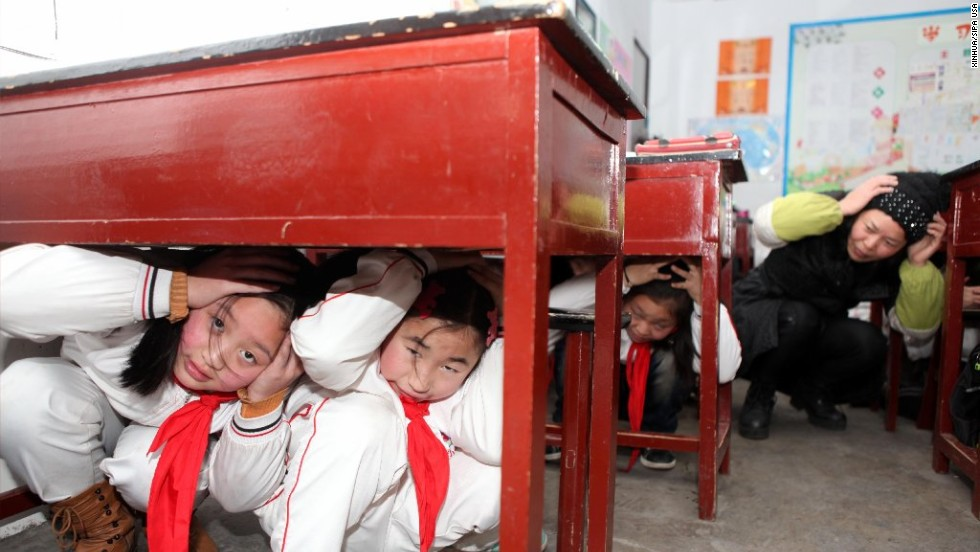 Children learn about disaster survival on February 17 at the Hongzhuan Primary School in Chongqing Municipality, China.