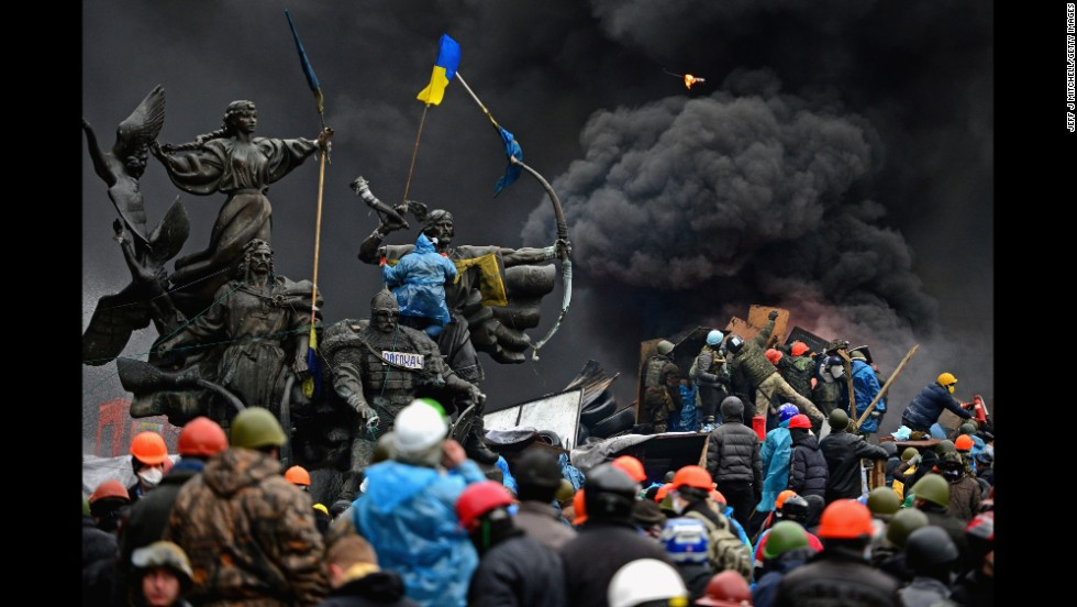 Protesters clash with police in Independence Square on February 20.
