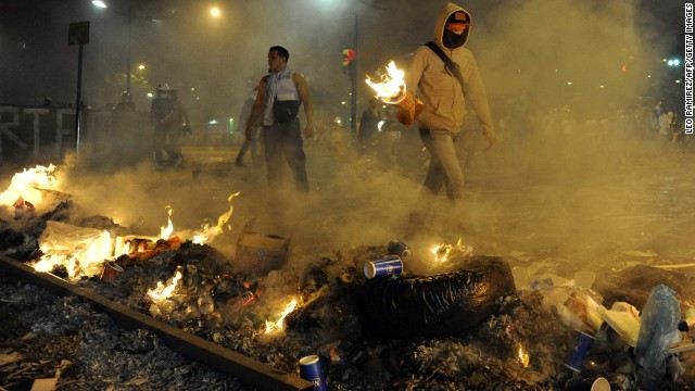 Protestors light fires during an anti-government demonstration in Caracas, Venezuela, on Wednesday, February 19.