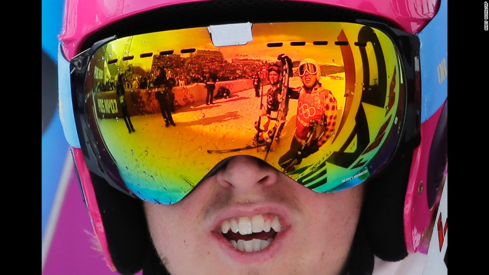 Competitors are reflected in the goggles of Sweden's John Eklund after their ski cross heat on February 20.
