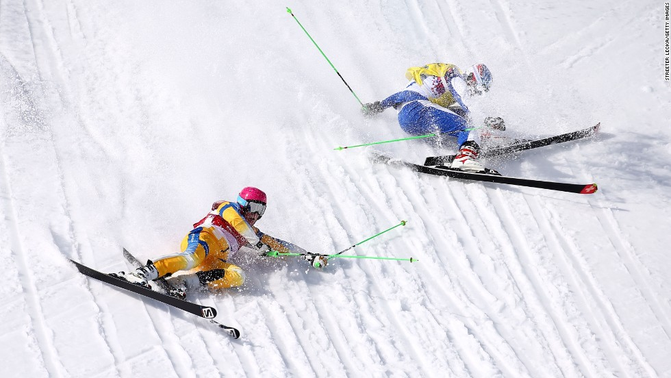 Victor Oehling Norberg of Sweden, left, and Egor Korotkov of Russia crash during the quarterfinals of the men's ski cross on February 20.