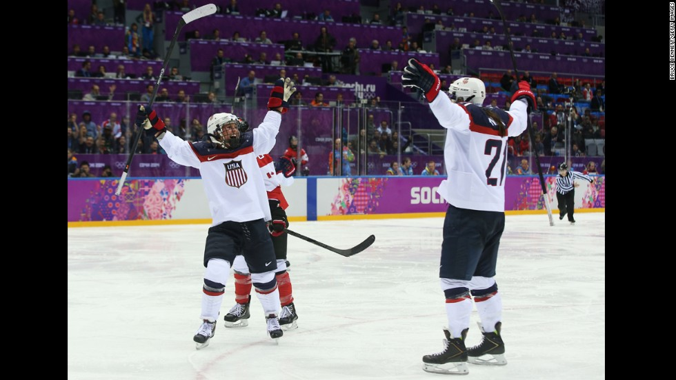 Alex Carpenter, left, and American teammate Hilary Knight celebrate Carpenter's third-period goal during the Canada game on February 20.