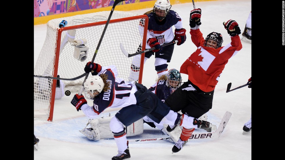 Canada's Marie-Philip Poulin, right, celebrates after scoring against the United States on February 20.