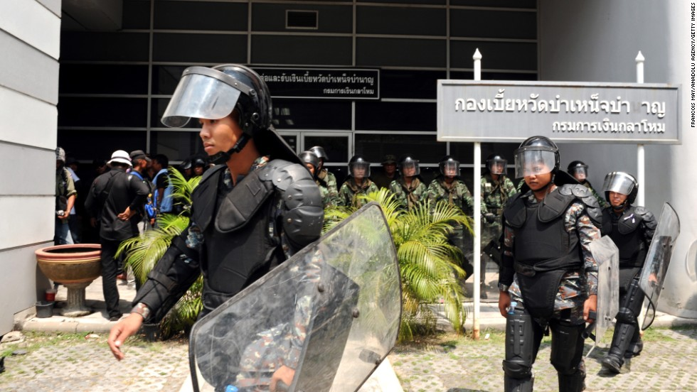 Security forces guard the temporary Thai government office during protests in Bangkok on February 19.