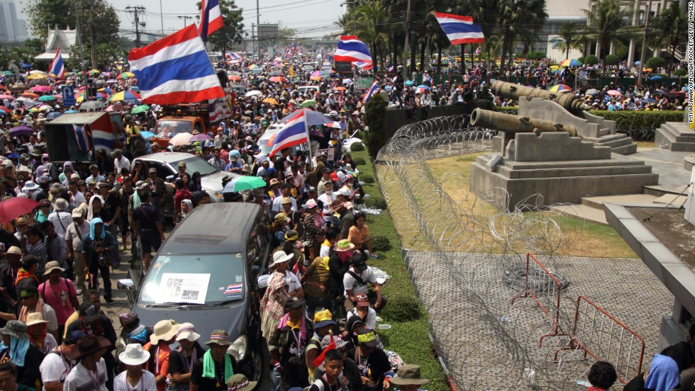 "Protesters rally in front of the defense ministry complex in Bangkok on February 19. The demonstrators want to replace Yingluck's government with an unelected ""people's council"" to see through electoral and political changes."