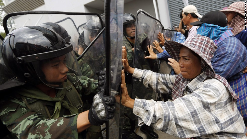 Thai rice farmers clash with security forces in Bangkok on Monday, February 17. The political crisis took on a new twist when a subsidy program that benefited rice farmers -- part of the Prime Minister's base -- was decried as corrupt by opposition leaders.