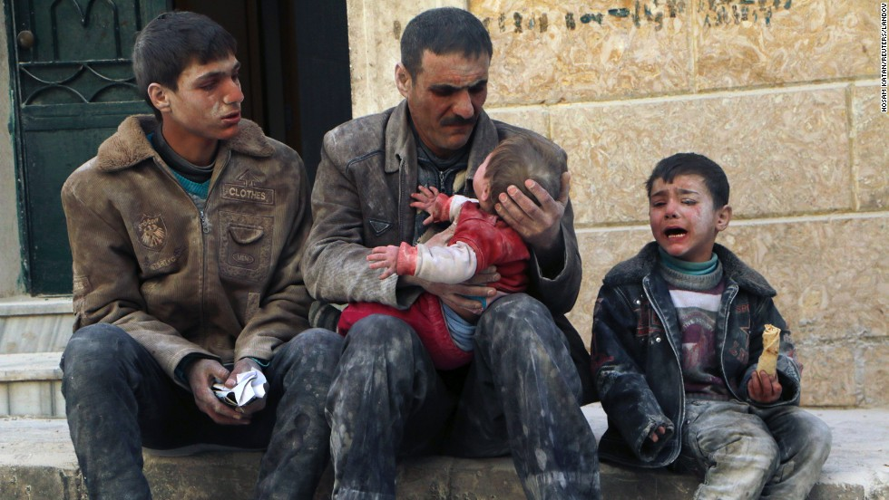 A man holds a baby who survived what activists say was an airstrike by al-Assad loyalists Friday, February 14, in Aleppo.