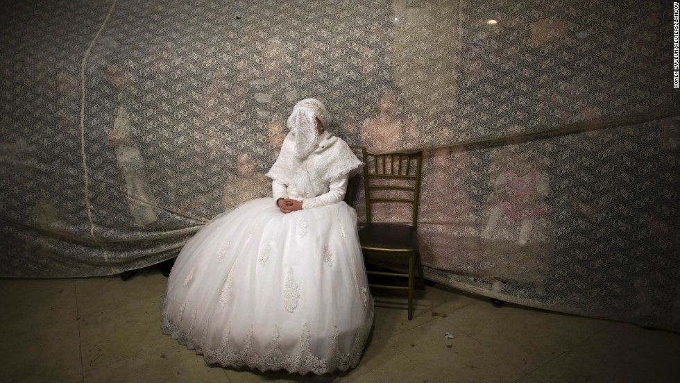 Ultraorthodox Jewish bride Rivka Hannah Krois watches her groom dance at their wedding in Jerusalem on February 19.