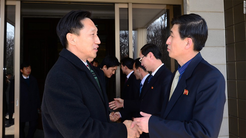 Lee Duk-Haeng (L), the head of South Korea's family reunion delegation, shakes hands with his North Korean counterpart Park Yong-Il (R) after their meeting on February 5, 2014 in Panmunjom, North Korea. Trust remains tenuous in the peninsula.