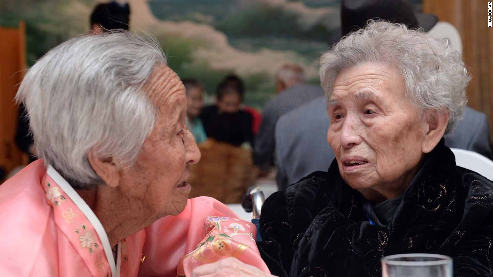 South Korean Lee Young-Shil (R), 88, meets with her North Korean sister Lee Jung-Shil. The rarity of inter-Korea reunions meant that even participants in ill health insisted on going to Mount Kumgang for the event, desperate for a chance to see their relatives.